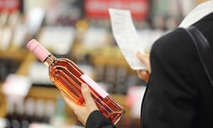 Businesswoman buying wine in the supermarket