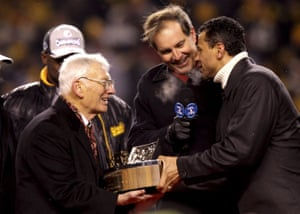 The late Pittsburgh Steelers owner Dan Rooney revciving a trophy in 2009. While the NFL's divesrity and inclusion chairman, Rooney introduced measures to address the lack of black managers in American football.