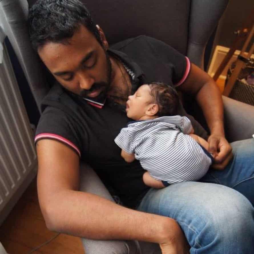 Ruwan Kodikara has a nap with his son.