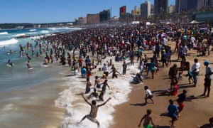 South Africans enjoy Durban beach on New Year's Day.
