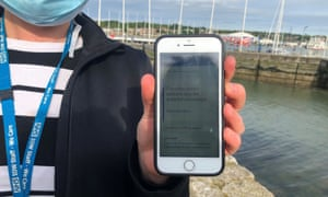 An NHS employee on the Isle of Wight uses the contact-tracing app.