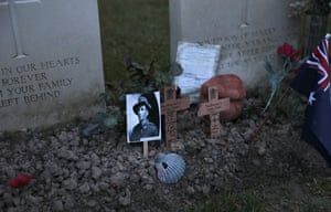 Zonnebeke, Belgium Cards and flowers are placed on the grave of John Hunter, a WWI Australian soldier, during an ANZAC Day dawn service at Buttes New British Cemetery