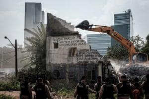 The demolition of Maria da Penha Macena's house in Rio de Janeiro's Vila Autódromo neighbourhood