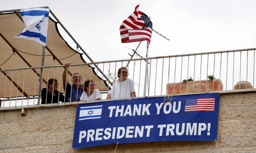 People look out from the balcony of their house near the US consulate in Jerusalem