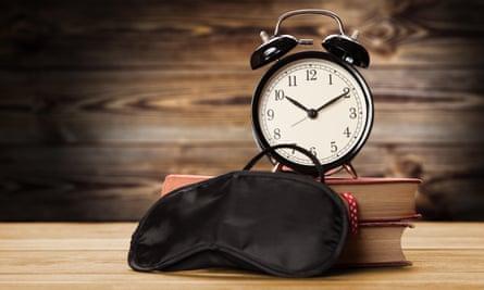 Alarm clock and eye mask