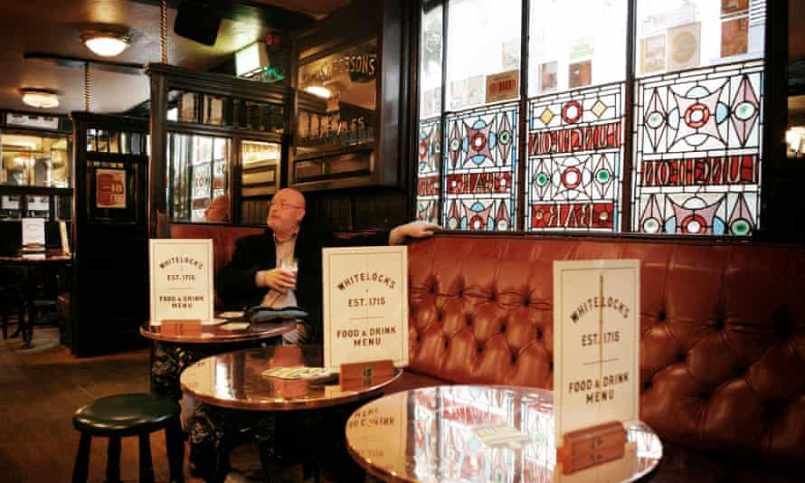 Interior of Whitelocks Pub, Leeds with stain glass windows