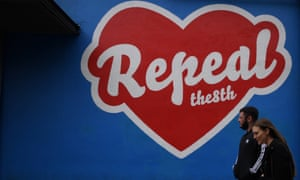 People walk past a pro-choice mural in Dublin ahead of the 25 May referendum on repealing the eighth amendment in the Irish constitution, which bans abortion.