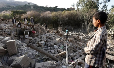 People search under the rubble of damaged houses following an airstrike on the outskirts of Yemen's capital, Sana'a