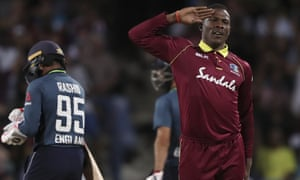 Sheldon Cottrell celebrates taking the wicket of England's Adil Rashid during the second ODI.