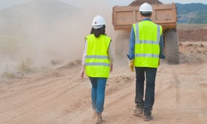 A male and female construction worker