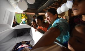 Relatives cry over the coffin of seven-year old Jakelin Caal, who died in a Texas hospital on 8 December, two days after being taken into custody by US border patrol agents.