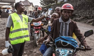 A health ministry worker checks people's temperature in Goma