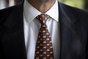 A spectator wears a topical swan tie