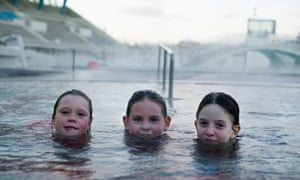 Three girls swimming in Laugardalslaug  pool