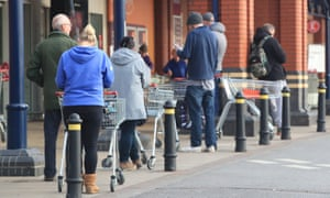 People queuing outside Sainsbury's.