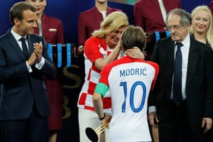Croatia's president Kolinda Grabar-Kitarović wipes away tears from Luka Modric's eyes as he is named player of the tournament.