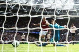 Marko Arnautovic of West Ham United scores past David De Gea of Manchester United for his sides third goal