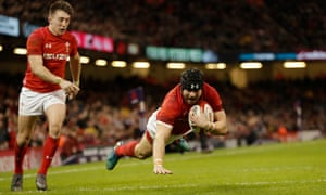 Leigh Halfpenny of Wales touches down for his team's third try against Scotland in Cardiff.