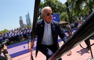 Joe Biden runs up onto the stage at his 2020 kickoff rally.