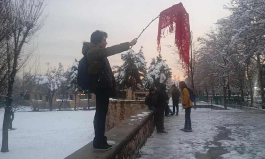 A Twitter image of an unidentified woman protesting against compulsory hijab rules