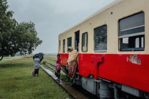 Rohingya passengers get off the train at the Zaw Pu Gyar terminus station. They will walk to their village which is only a couple of hundred metres away, making sure not to enter the Buddhist village