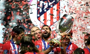 Diego Costa lifts the trophy after his two goals helped Atlético Madrid to win the Super Cup.