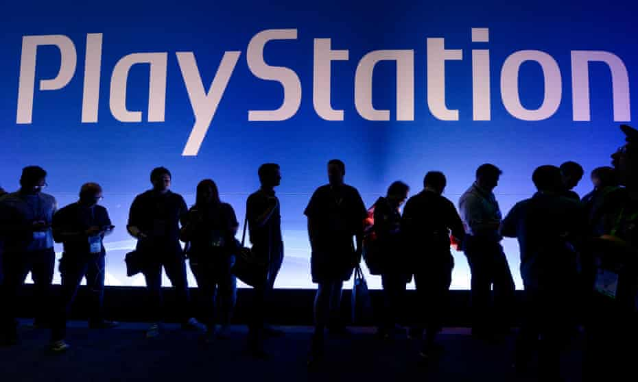 Players queue at the PlayStation booth at E3 in Los Angeles.