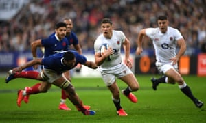 Owen Farrell breaks through the tackle of Boris Palu of France on an afternoon when England were badly beaten.