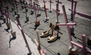 High heel shoes are seen in front of a cross outside the Municipal Palace of Ecatepec during a protest against femicides.