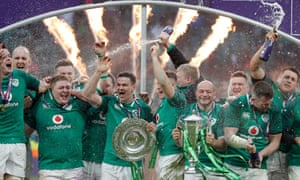 Ireland celebrate as captain Rory Best holds the Six Nations trophy and Jonnie Sexton clutches the Triple Crown shield after their victory over England gave them the Grand Slam in March 2018.