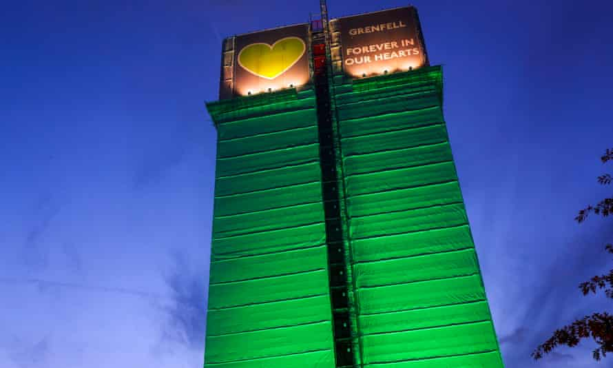 The remains of Grenfell Tower wrapped in green to commemorate victims of the fire