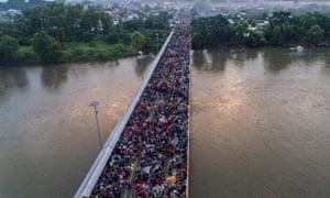 Aerial view of a Honduran migrant caravan heading to the US, on the Guatemala-Mexico international border bridge in Ciudad Hidalgo, Chiapas state, Mexico, on October 20, 2018.