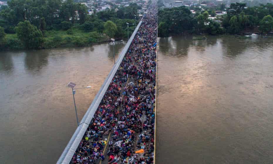 Aerial view of the Honduran migrant caravan on the Guatemala-Mexico international border bridge in Ciudad Hidalgo, Mexico.