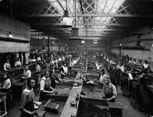 Workers cast mouldings in the core shop at Leys Malleable Castings Company. This image comes from a set of rarely seen photographs of industrial practices from one of the UK's largest industrial companies at the time. They will be exhibited at the Format photography festival in Derby from 8 March to 7 April.<br>