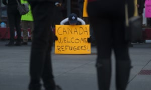 People took to the streets at Yonge-Dundas square in Toronto on Sunday with banners and signs rejecting Islamophobia and welcoming refugees.