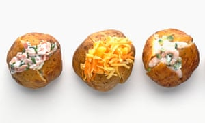 Four jacket potatoes in a row with different fillings.