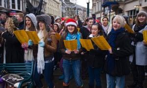 High school charity carol singers in Newport, south Wales.