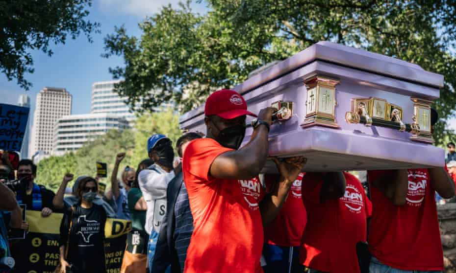 Activists in Austin, Texas, carried a coffin to symbolize the death of voting rights, during a 27-mile march for democracy in July.