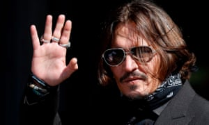 Johnny Depp waves outside the high court in London.