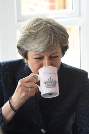 Princess. Theresa May enjoys a brew in Walkden near Manchester in 2017