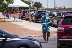 A long line of cars make their way as US Army personnel lead a Covid-19 drive-thru testing site in El Paso, Texas, USA on 10 July, 2020. El Paso has reported sharp rises in the number of coronavirus cases.