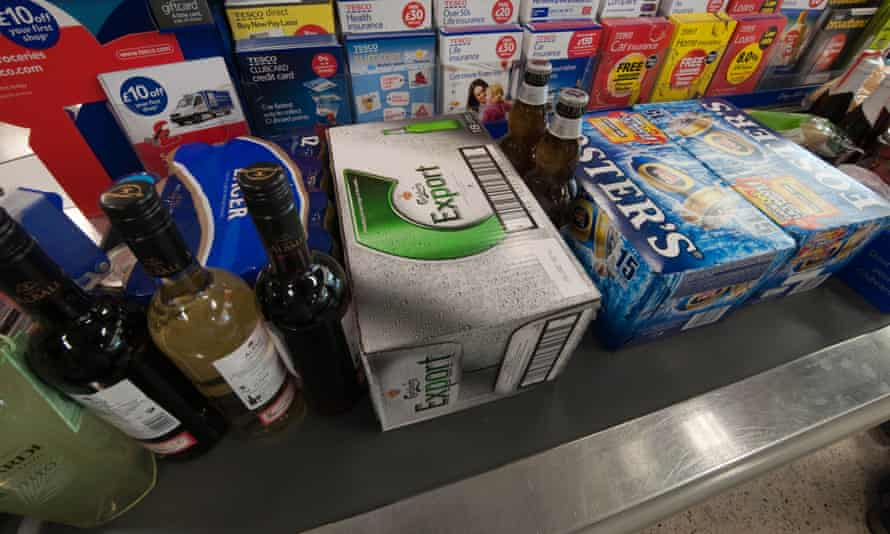 wine and beer on a supermarket checkout conveyor belt