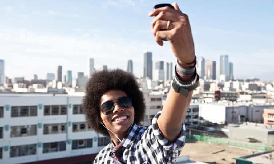 Man taking selfie on rooftop