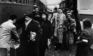 Hungarian refugees boarding a train in Austria following the 1956 uprising.