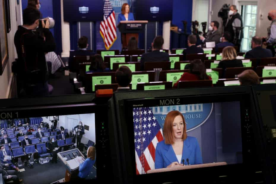 Jen Psaki is seen on a monitor during the daily briefing at the White House on 2 February.