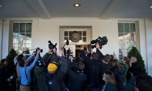 Members of the press follow Kellyanne Conway as she speaks about a potential government shutdown on Friday.