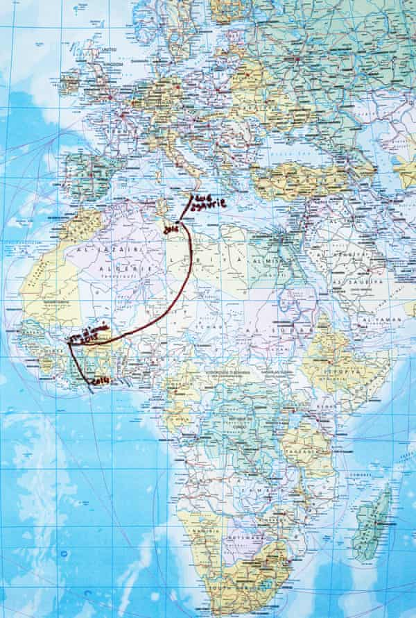 Migrants rescued by Red Cross durring crossing between Libya and Italy. Mineo, Sicily. ITALY The route map of Maria and Joel, both 19 old from Mali.