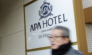 A man walks past the entrance of an APA hotel in Tokyo.