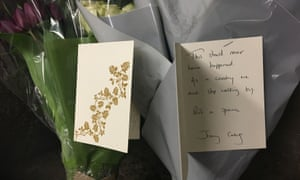 Flowers and cards for a homeless man who died near Westminster
