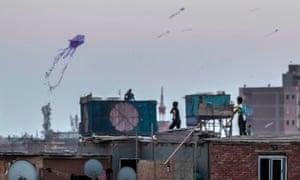 Children flying kites in Cairo, Egypt.